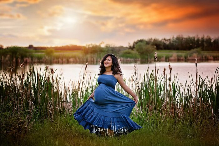 fall maternity photography with blue sundress location st albert field by pond