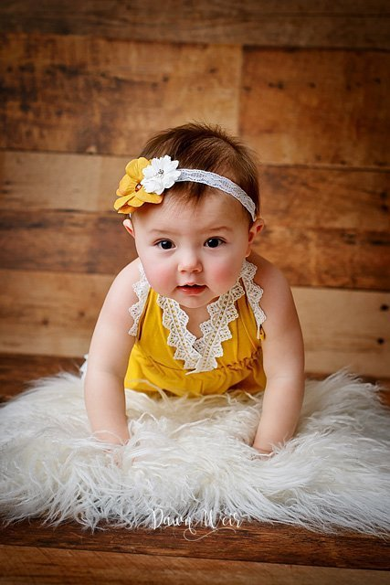photo-by-cake-smash-photographer-dawn-weir-one-year-old-mustard-lace-romper-wood-backdrop