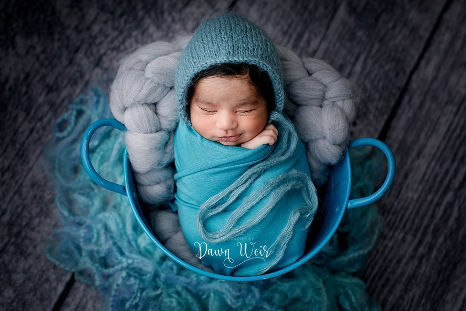 photo by photography by dawn weir newborn boy turquoise wrap in bucket