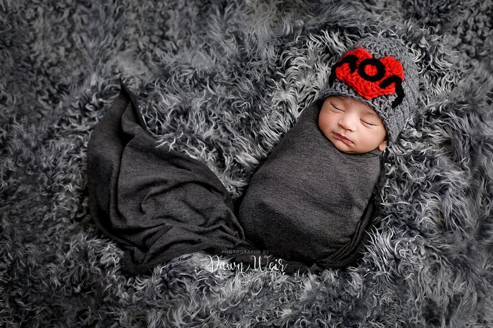 photo by photography by dawn weir newborn boy grey wrap on grey fur love mom hat