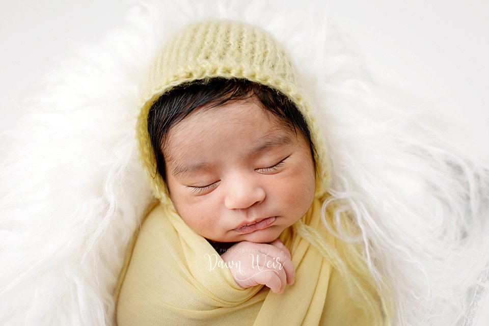photo by photography by dawn weir newborn boy yellow wrap on white fur