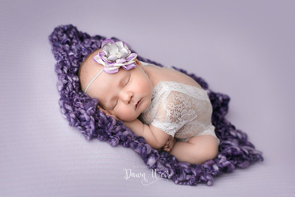 photo by dawn weir newborn girl lying on blanket bum up lace outfit  purple blanket