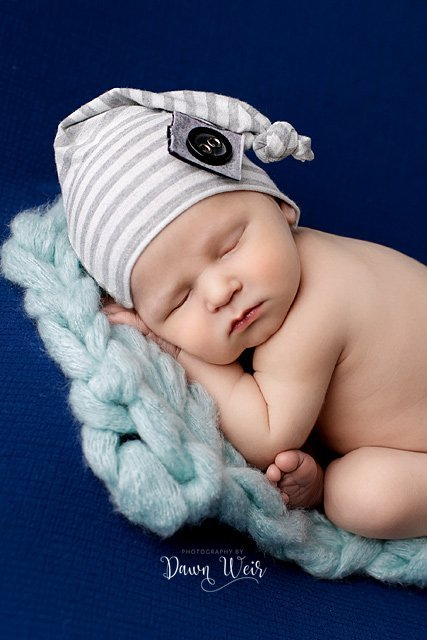 photo by dawn weir edmonton newborn boy on blue blanket with turquoise knit and grey striped hat