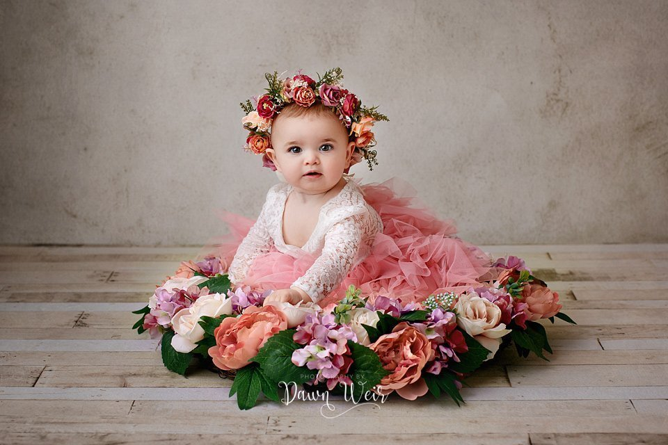 edmonton cake smash photographer dawn weir dusty rose flowers one year old girl flower headband sitting in flowers