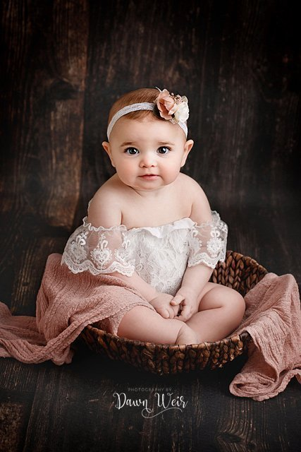 edmonton cake smash photographer dawn weir white lace over the shoulder romper on a one year old girl sitting in a bucket