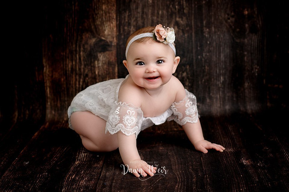edmonton cake smash photographer dawn weir white lace over the shoulder romper on a one year old girl