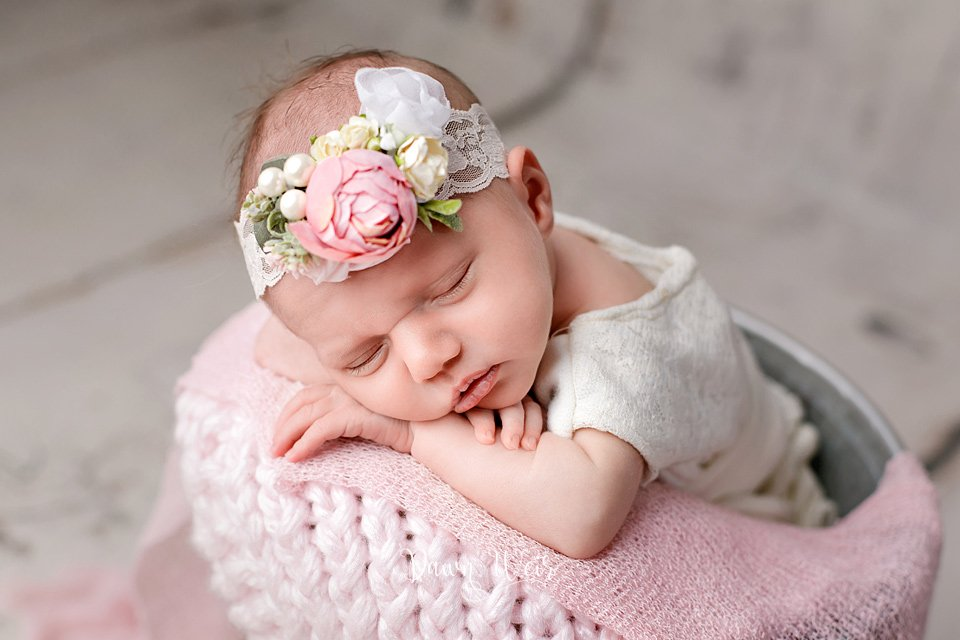 edmonton newborn photographer dawn weir pink accents in bucket baby girl