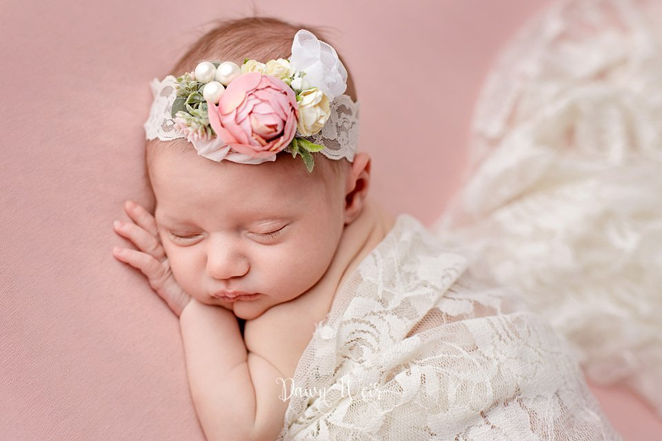 edmonton newborn photographer dawn weir baby girl lying on dusty rose pink blanket